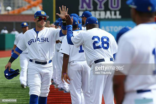 Dante Bichette Jr #19 of Team Brazil is greeted by teammates during player introductions prior to Game 3 of the 2016 World Baseball Classic Qualifier...