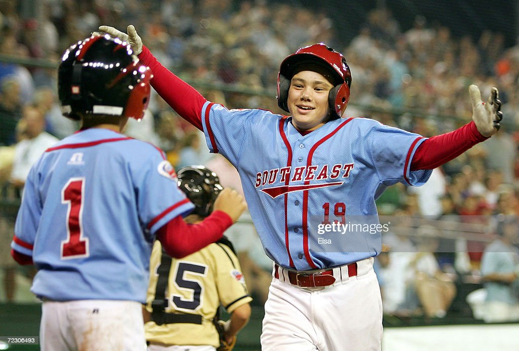 Dante Bichette Jr #19 celebrates as he crosses the plate with teammate Max Moroff #1 during the United States Semifinal of the Little League World Series on August 24, 2005 at Lamade Stadium in South Williamsport, Pennsylvania. The West team from Vista, California defeated the Southeast team from Maitland, Florida 6-2.