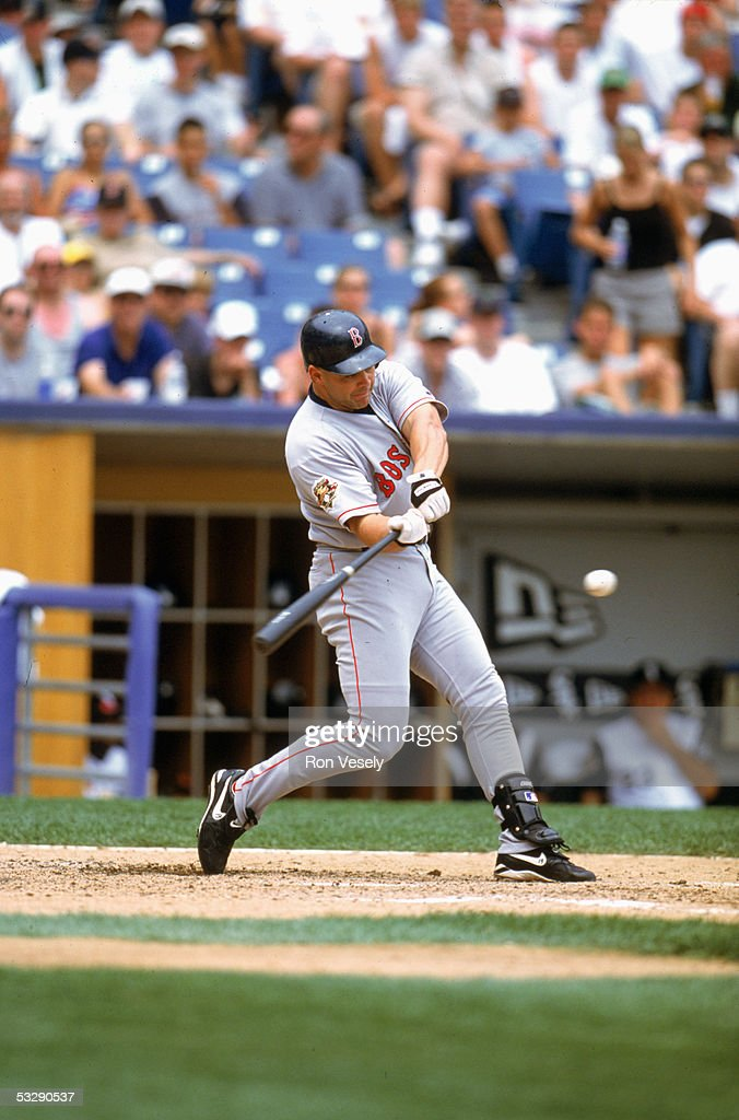 Dante Bichette of the Boston Red Sox bats during an MLB game at Comiskey Park in Chicago, Illinois. Dante Bichette played for the Boston Red Sox from 2000-2001.