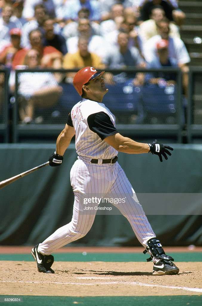Dante Bichette of the Cincinnati Reds watches the flight of his hit during an MLB game on June 29, 2000 at Cinergy Field in Cincinnati, Ohio.