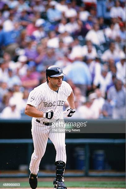 Dante Bichette of the Colorado Rockies bats against the Atlanta Braves at Coors Field on September 12 1996 in Denver Colorado The Rockies defeated...