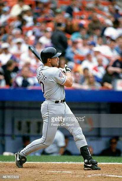 Dante Bichette of the Colorado Rockies bats against the New York Mets during an Major League Baseball game circa 1997 at Shea Stadium in the Queens...
