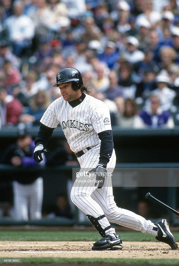 Dante Bichette #10 of the Colorado Rockies bats during an Major League Baseball game circa 1995 at Coors Field in Denver, Colorado. Bichette played for the Rockies from 1993-99.