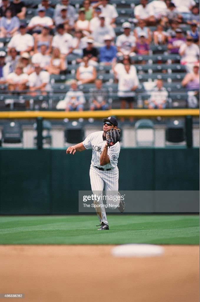 Dante Bichette of the Colorado Rockies fields against the Montreal Expos at Coors Field on August 15, 1999 in Denver, Colorado.