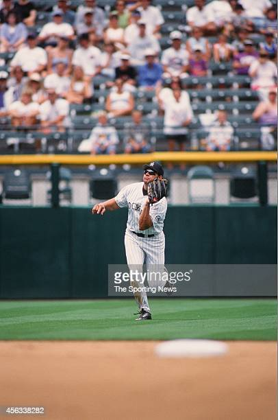 Dante Bichette of the Colorado Rockies fields against the Montreal Expos at Coors Field on August 15 1999 in Denver Colorado