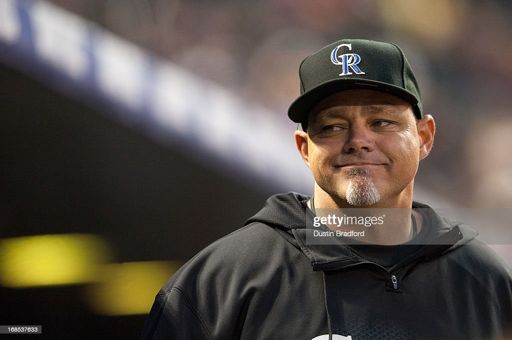 Dante Bichette #10 of the Colorado Rockies looks out from the dugout during a game against the New York Yankees at Coors Field on May 8, 2013 in Denver, Colorado.