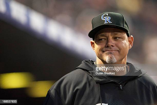 Dante Bichette of the Colorado Rockies looks out from the dugout during a game against the New York Yankees at Coors Field on May 8 2013 in Denver...