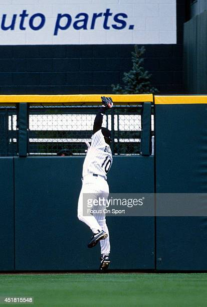Dante Bichette of the Colorado Rockies makes a leaping catch during an Major League Baseball game circa 1996 at Coors Field in Denver Colorado...
