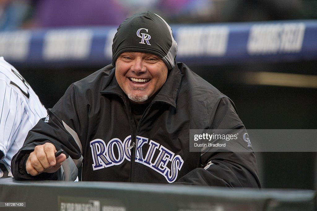 Dante Bichette #10 of the Colorado Rockies smiles in the dugout before a game against the Arizona Diamondbacks at Coors Field on April 20, 2013 in Denver, Colorado. The Rockies beat the Diamondbacks 4-3.