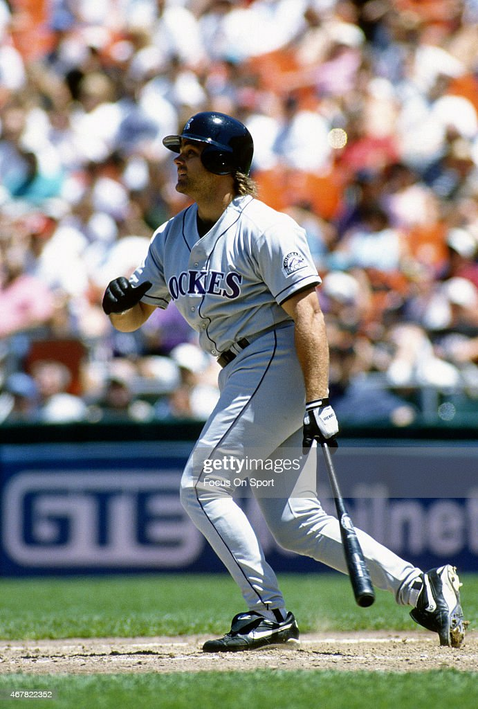 Dante Bichette #10 of the Colorado Rockies swings and watches the flight of his ball against the San Francisco Giants during an Major League Baseball game circa 1995 at Candlestick Park in San Francisco, California. Bichette played for the Rockies from 1993-99.