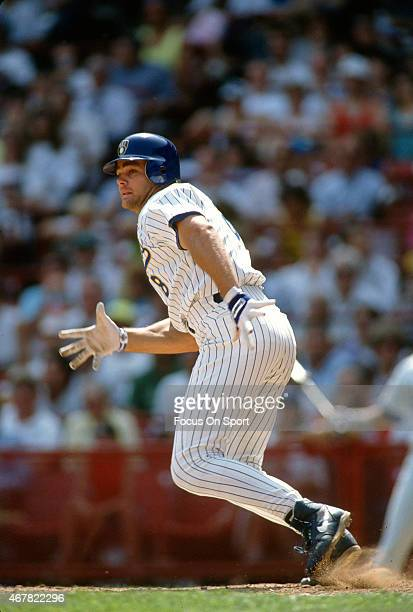 Dante Bichette of the Milwaukee Brewers puts the ball in play and runs towards first base during an Major League Baseball game circa 1992 at...