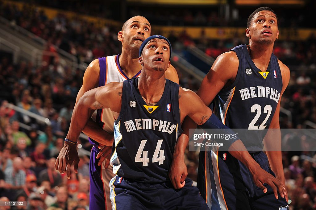 Dante Cunningham #44 and Rudy Gay #22 of the Memphis Grizzlies hold Jared Dudley #3 of the Phoenix Suns in position during an NBA game played on March 10, 2012 at U.S. Airways Center in Phoenix, Arizona.