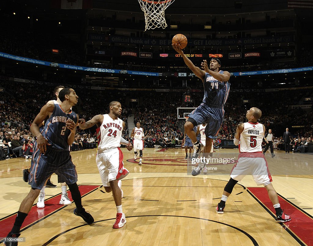 <a gi-track='captionPersonalityLinkClicked' href=/galleries/search?phrase=Dante+Cunningham&family=editorial&specificpeople=683729 ng-click='$event.stopPropagation()'>Dante Cunningham</a> #44 of the Charlotte Bobcats shoots against <a gi-track='captionPersonalityLinkClicked' href=/galleries/search?phrase=Jerryd+Bayless&family=editorial&specificpeople=4216027 ng-click='$event.stopPropagation()'>Jerryd Bayless</a> #5 of the Toronto Raptors during the game on March 13, 2011 at the Air Canada Centre in Toronto, Ontario, Canada.