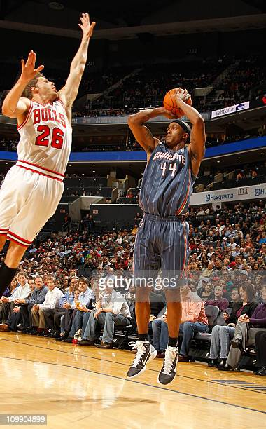 Dante Cunningham of the Charlotte Bobcats shoots against Kyle Korver of the Chicago Bulls on March 9 2011 at Time Warner Cable Arena in Charlotte...