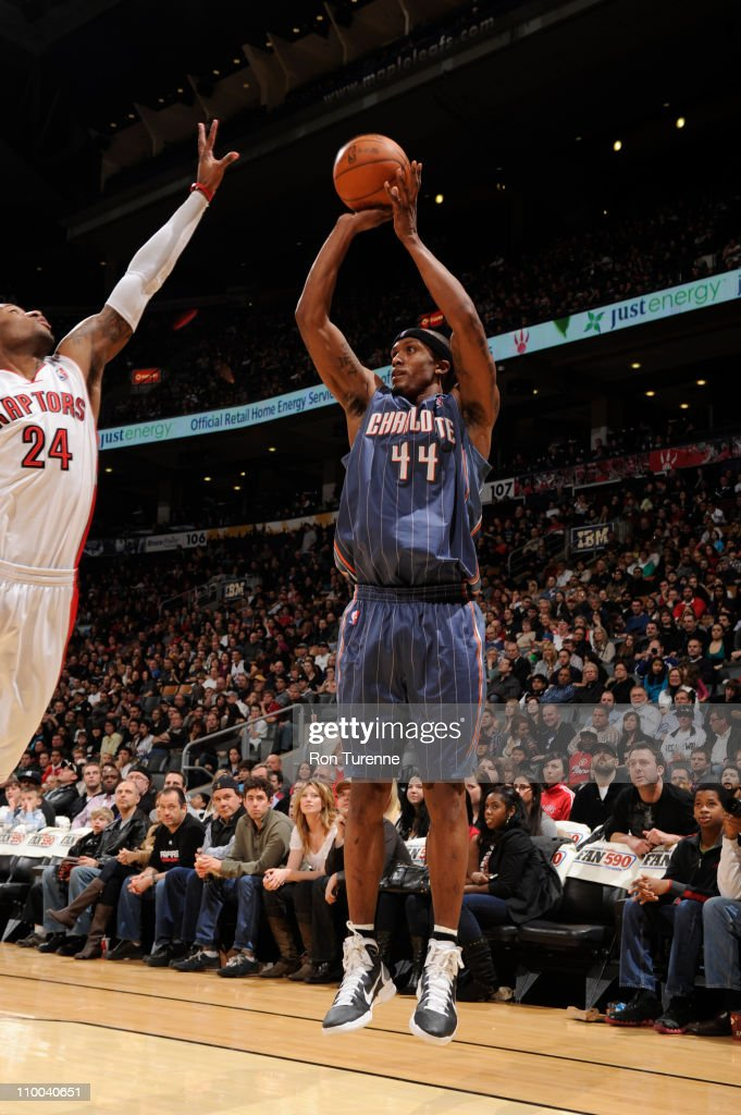 <a gi-track='captionPersonalityLinkClicked' href=/galleries/search?phrase=Dante+Cunningham&family=editorial&specificpeople=683729 ng-click='$event.stopPropagation()'>Dante Cunningham</a> #44 of the Charlotte Bobcats shoots against <a gi-track='captionPersonalityLinkClicked' href=/galleries/search?phrase=Sonny+Weems&family=editorial&specificpeople=4099569 ng-click='$event.stopPropagation()'>Sonny Weems</a> #24 of the Toronto Raptors during the game on March 13, 2011 at the Air Canada Centre in Toronto, Ontario, Canada.