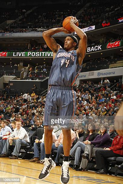 Dante Cunningham of the Charlotte Bobcats shoots the ball during the game against the Chicago Bulls on March 9 2011 at Time Warner Cable Arena in...
