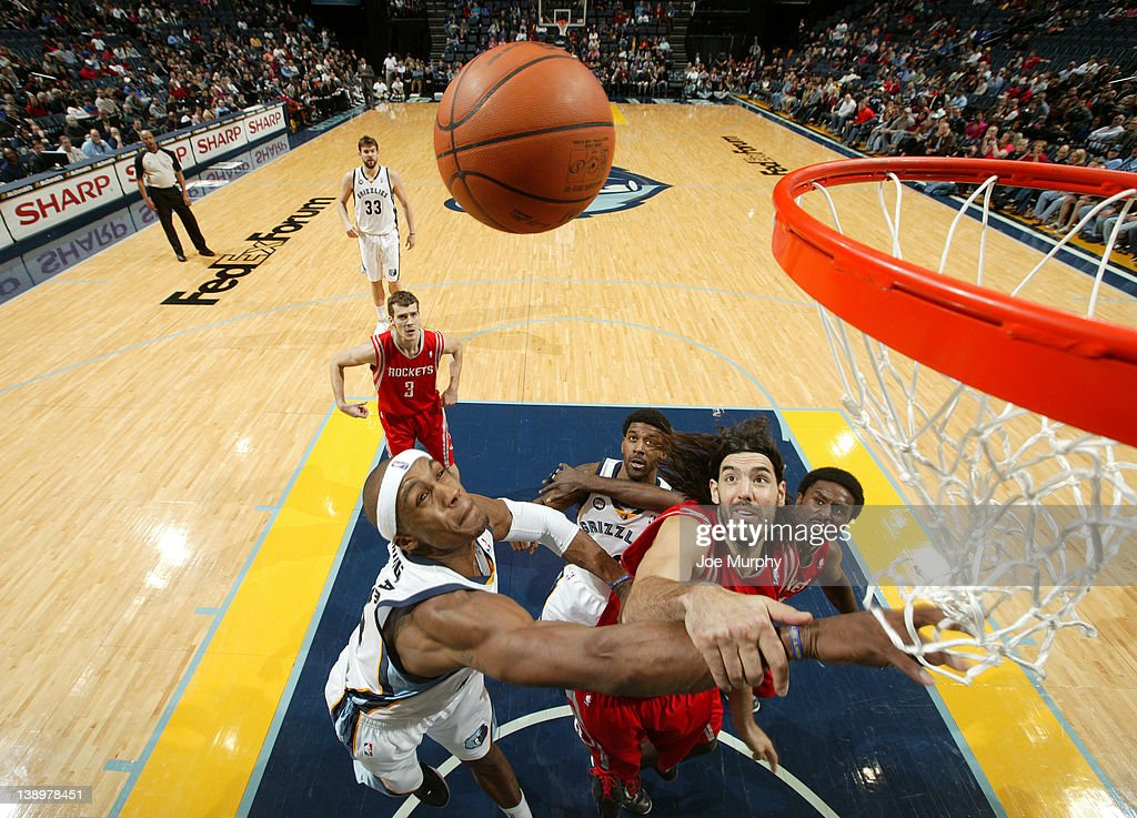 <a gi-track='captionPersonalityLinkClicked' href=/galleries/search?phrase=Dante+Cunningham&family=editorial&specificpeople=683729 ng-click='$event.stopPropagation()'>Dante Cunningham</a> #44 of the Memphis Grizzlies fights for a rebound against <a gi-track='captionPersonalityLinkClicked' href=/galleries/search?phrase=Luis+Scola&family=editorial&specificpeople=2464749 ng-click='$event.stopPropagation()'>Luis Scola</a> #4 of the Houston Rockets on February 14, 2012 at FedExForum in Memphis, Tennessee.