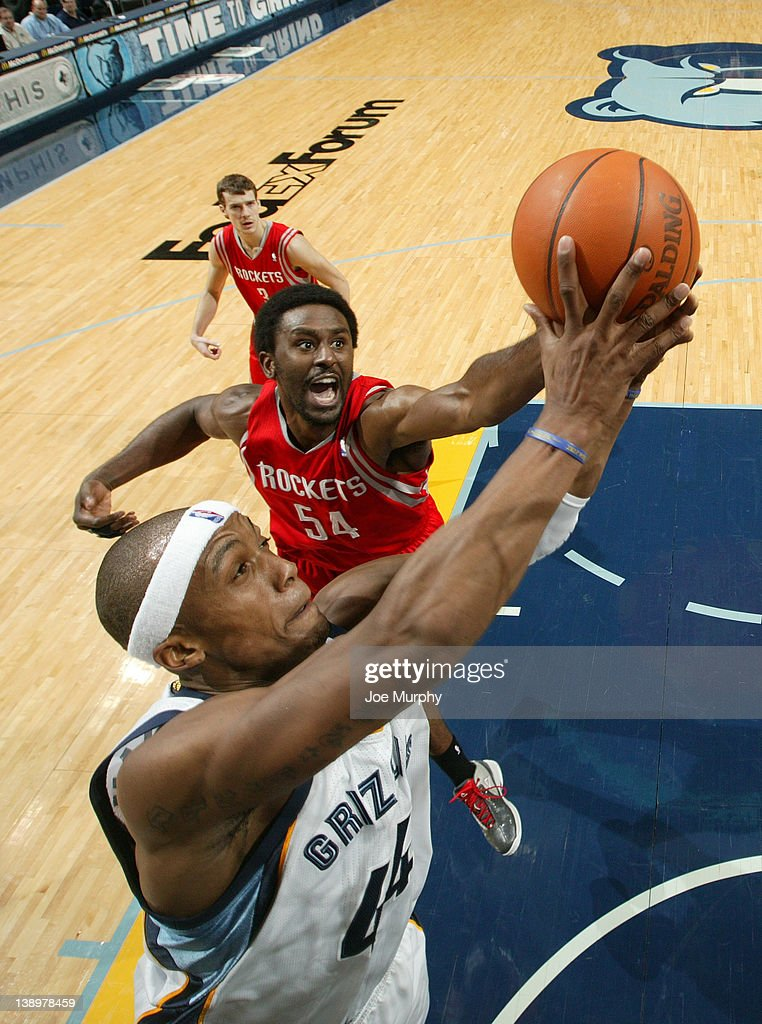 <a gi-track='captionPersonalityLinkClicked' href=/galleries/search?phrase=Dante+Cunningham&family=editorial&specificpeople=683729 ng-click='$event.stopPropagation()'>Dante Cunningham</a> #44 of the Memphis Grizzlies shoots against <a gi-track='captionPersonalityLinkClicked' href=/galleries/search?phrase=Patrick+Patterson&family=editorial&specificpeople=2928099 ng-click='$event.stopPropagation()'>Patrick Patterson</a> #54 of the Houston Rockets on February 14, 2012 at FedExForum in Memphis, Tennessee.