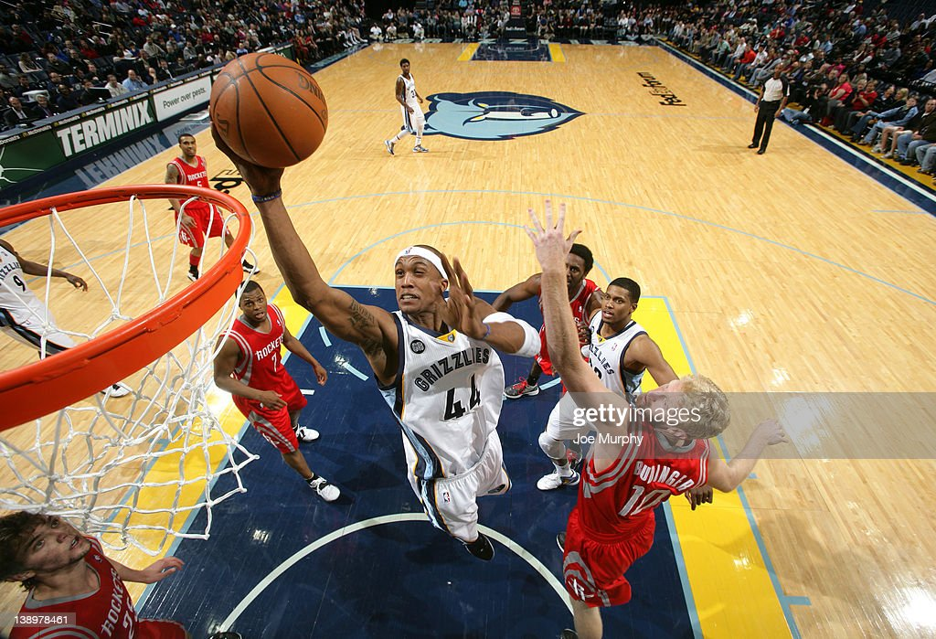 <a gi-track='captionPersonalityLinkClicked' href=/galleries/search?phrase=Dante+Cunningham&family=editorial&specificpeople=683729 ng-click='$event.stopPropagation()'>Dante Cunningham</a> #44 of the Memphis Grizzlies shoots over <a gi-track='captionPersonalityLinkClicked' href=/galleries/search?phrase=Chase+Budinger&family=editorial&specificpeople=3847600 ng-click='$event.stopPropagation()'>Chase Budinger</a> #10 of the Houston Rockets on February 14, 2012 at FedExForum in Memphis, Tennessee.