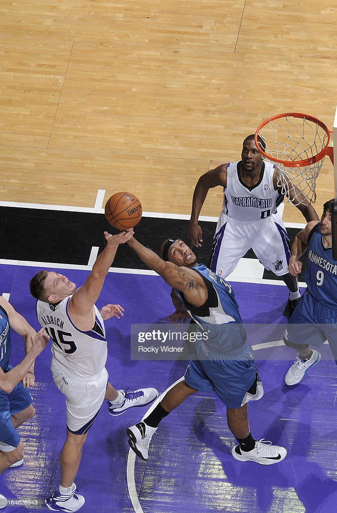 Dante Cunningham #33 of the Minnesota Timberwolves battles Cole Aldrich #45 of the Sacramento Kings for the rebound on March 21, 2013 at Sleep Train Arena in Sacramento, California.
