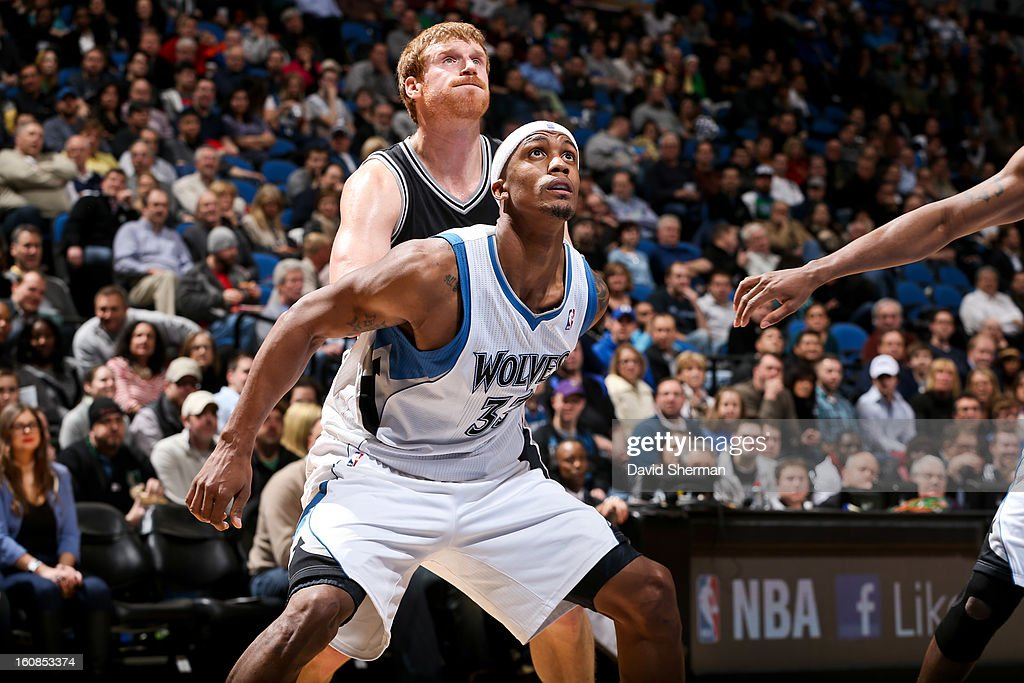 Dante Cunningham #33 of the Minnesota Timberwolves battles for rebound position against Matt Bonner #15 of the San Antonio Spurs on February 6, 2013 at Target Center in Minneapolis, Minnesota.