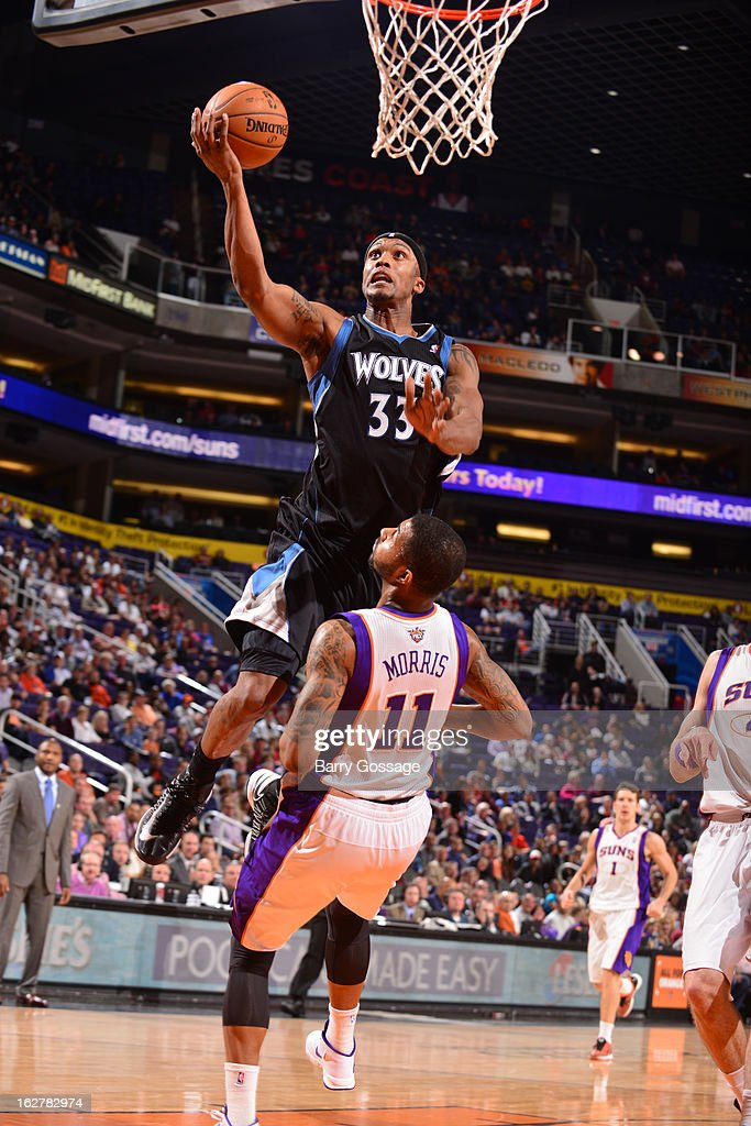 <a gi-track='captionPersonalityLinkClicked' href=/galleries/search?phrase=Dante+Cunningham&family=editorial&specificpeople=683729 ng-click='$event.stopPropagation()'>Dante Cunningham</a> #33 of the Minnesota Timberwolves drives for a layup against <a gi-track='captionPersonalityLinkClicked' href=/galleries/search?phrase=Markieff+Morris&family=editorial&specificpeople=5293881 ng-click='$event.stopPropagation()'>Markieff Morris</a> #11 of the Phoenix Suns on February 26, 2013 at U.S. Airways Center in Phoenix, Arizona.