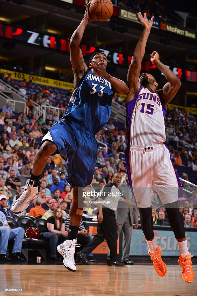 Dante Cunningham #33 of the Minnesota Timberwolves drives for a shot against Marcus Morris #15 of the Phoenix Suns on March 22, 2013 at U.S. Airways Center in Phoenix, Arizona.