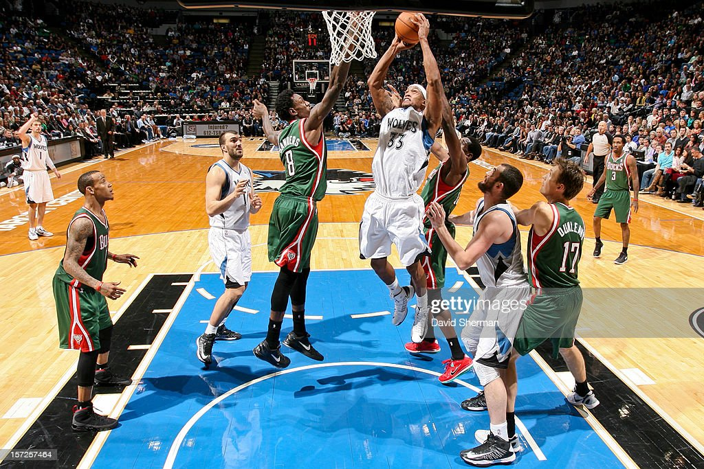 Dante Cunningham #33 of the Minnesota Timberwolves drives to the basket against Larry Sanders #8 of the Milwaukee Bucks on November 30, 2012 at Target Center in Minneapolis, Minnesota.