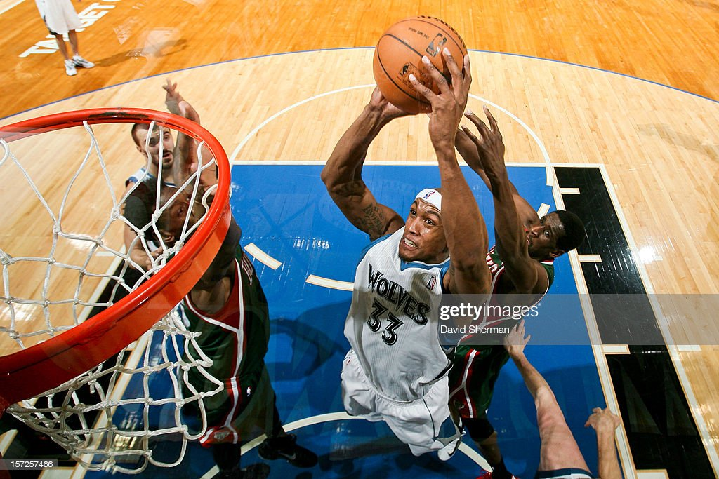 <a gi-track='captionPersonalityLinkClicked' href=/galleries/search?phrase=Dante+Cunningham&family=editorial&specificpeople=683729 ng-click='$event.stopPropagation()'>Dante Cunningham</a> #33 of the Minnesota Timberwolves drives to the basket against the Milwaukee Bucks on November 30, 2012 at Target Center in Minneapolis, Minnesota.