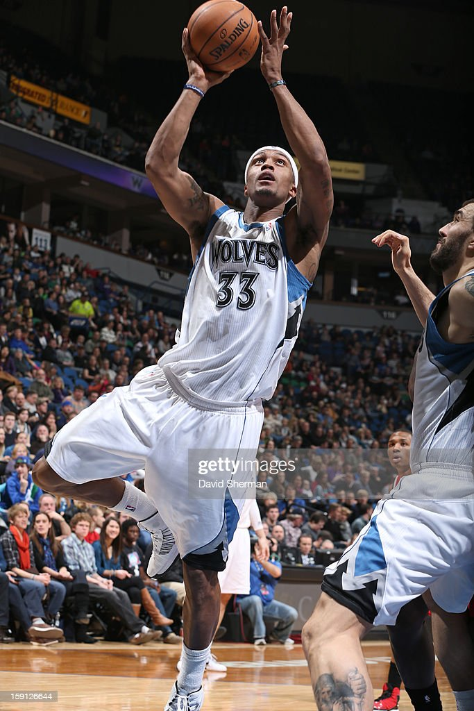 <a gi-track='captionPersonalityLinkClicked' href=/galleries/search?phrase=Dante+Cunningham&family=editorial&specificpeople=683729 ng-click='$event.stopPropagation()'>Dante Cunningham</a> #33 of the Minnesota Timberwolves drives to the basket against the Portland Trail Blazers on January 5, 2013 at Target Center in Minneapolis, Minnesota.