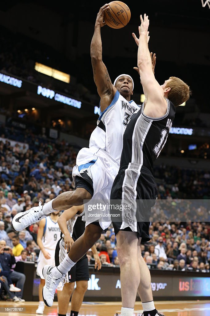 <a gi-track='captionPersonalityLinkClicked' href=/galleries/search?phrase=Dante+Cunningham&family=editorial&specificpeople=683729 ng-click='$event.stopPropagation()'>Dante Cunningham</a> #33 of the Minnesota Timberwolves drives to the basket against the San Antonio Spurs on March 12, 2013 at Target Center in Minneapolis, Minnesota.