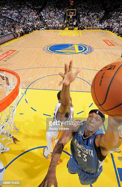 Dante Cunningham of the Minnesota Timberwolves drives to the basket against the Golden State Warriors on April 14 2014 at Oracle Arena in Oakland...