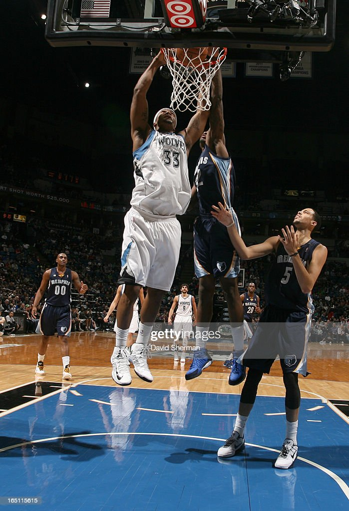 Dante Cunningham #33 of the Minnesota Timberwolves dunks the ball during the game between the Memphis Grizzlies and the Minnesota Timberwolves on March 30, 2013 at Target Center in Minneapolis, Minnesota.
