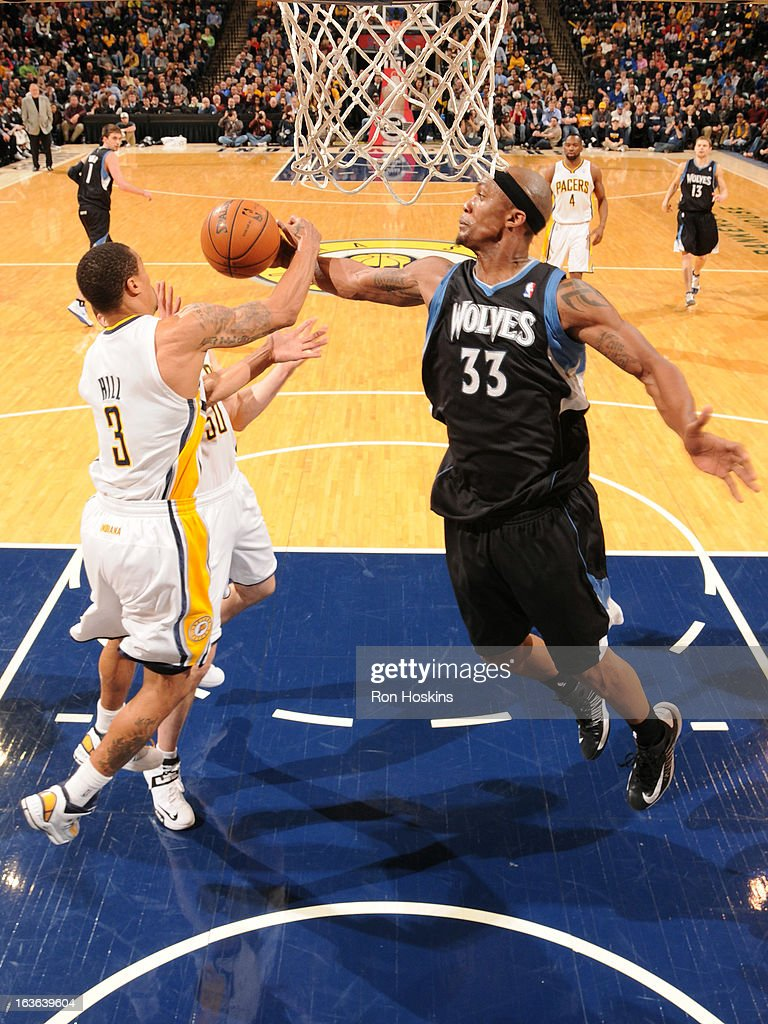 <a gi-track='captionPersonalityLinkClicked' href=/galleries/search?phrase=Dante+Cunningham&family=editorial&specificpeople=683729 ng-click='$event.stopPropagation()'>Dante Cunningham</a> #33 of the Minnesota Timberwolves gains the ball control against George Hill #3 of the Indiana Pacers during the game between the Indiana Pacers and the Minnesota Timberwolves on March 13, 2013 at Bankers Life Fieldhouse in Indianapolis, Indiana.