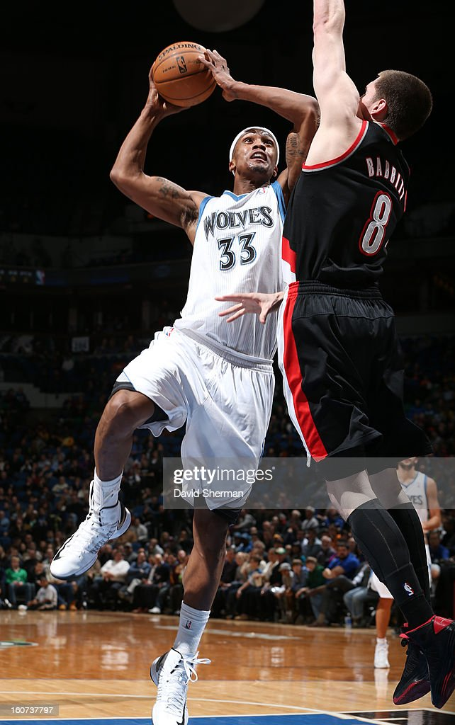 <a gi-track='captionPersonalityLinkClicked' href=/galleries/search?phrase=Dante+Cunningham&family=editorial&specificpeople=683729 ng-click='$event.stopPropagation()'>Dante Cunningham</a> #33 of the Minnesota Timberwolves goes to the basket against <a gi-track='captionPersonalityLinkClicked' href=/galleries/search?phrase=Luke+Babbitt&family=editorial&specificpeople=5122155 ng-click='$event.stopPropagation()'>Luke Babbitt</a> #8 of the Portland Trail Blazers during the game between the Minnesota Timberwolves and the Portland Trail Blazers on February 4, 2013 at Target Center in Minneapolis, Minnesota.