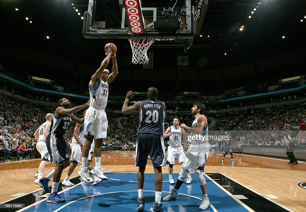 Dante Cunningham #33 of the Minnesota Timberwolves goes to the basket during the game between the Memphis Grizzlies and the Minnesota Timberwolves on March 30, 2013 at Target Center in Minneapolis, Minnesota.
