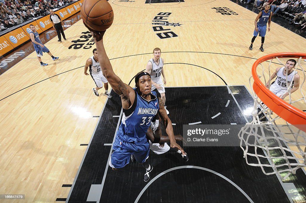 Dante Cunningham #33 of the Minnesota Timberwolves goes up for the dunk against the San Antonio Spurs on April 17, 2013 at the AT&T Center in San Antonio, Texas.