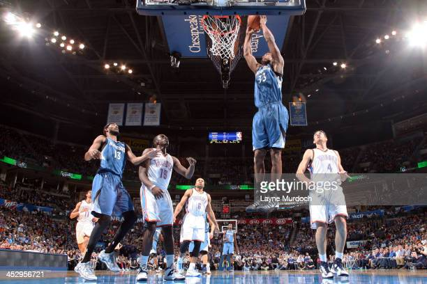 Dante Cunningham of the Minnesota Timberwolves goes up for the dunk against the Oklahoma City Thunder during an NBA game on December 1 2013 at the...
