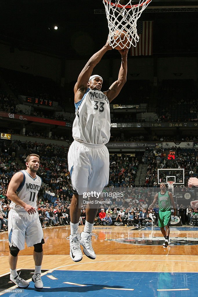 Dante Cunningham #33 of the Minnesota Timberwolves goes up for the rebound against the Boston Celtics during the game on April 1, 2013 at Target Center in Minneapolis, Minnesota.