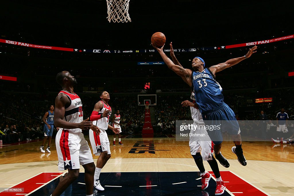 <a gi-track='captionPersonalityLinkClicked' href=/galleries/search?phrase=Dante+Cunningham&family=editorial&specificpeople=683729 ng-click='$event.stopPropagation()'>Dante Cunningham</a> #33 of the Minnesota Timberwolves grabs a rebound against the Washington Wizards at the Verizon Center on January 25, 2013 in Washington, DC.