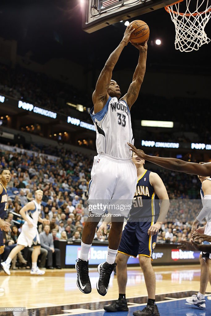 <a gi-track='captionPersonalityLinkClicked' href=/galleries/search?phrase=Dante+Cunningham&family=editorial&specificpeople=683729 ng-click='$event.stopPropagation()'>Dante Cunningham</a> #33 of the Minnesota Timberwolves grabs the rebound against the Indiana Pacers on November 9, 2012 at Target Center in Minneapolis, Minnesota.