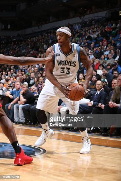 Dante Cunningham of the Minnesota Timberwolves looks to drive to the basket against the Houston Rockets during the game on February 10 2014 at Target...