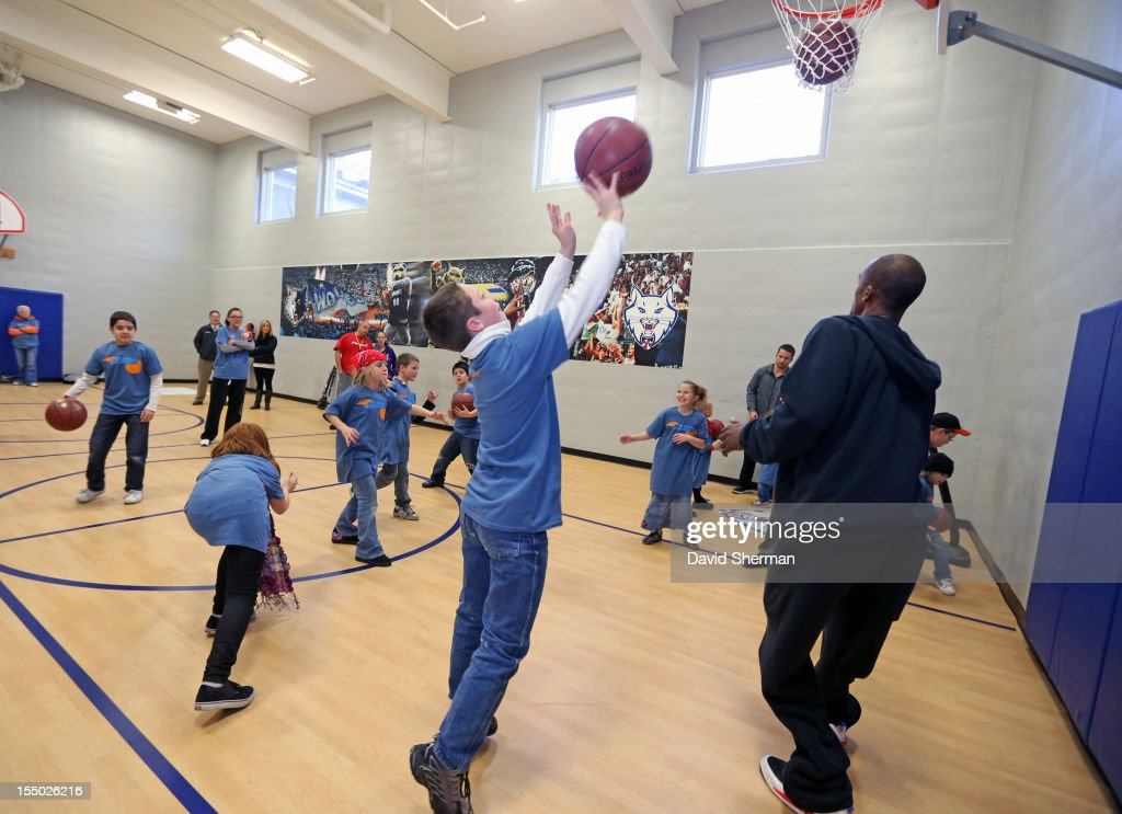 Dante Cunningham of the Minnesota Timberwolves plays basketball with kids after dedicating a refurbished basketball court on October 30, 2012 at the Ronald McDonald House - Oak Street in Minneapolis, Minnesota.