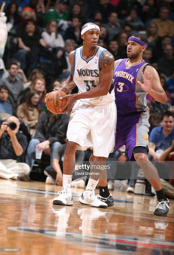Dante Cunningham #33 of the Minnesota Timberwolves protects the ball from Jared Dudley #3 of the Phoenix Suns during the game between the Phoenix Suns and the Minnesota Timberwolves on April 13, 2013 at Target Center in Minneapolis, Minnesota.