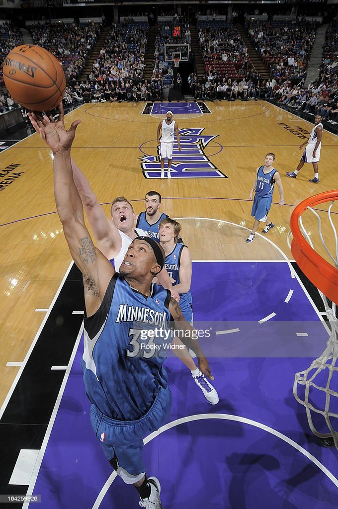 Dante Cunningham #33 of the Minnesota Timberwolves rebounds the ball against Cole Aldrich #45 of the Sacramento Kings on March 21, 2013 at Sleep Train Arena in Sacramento, California.