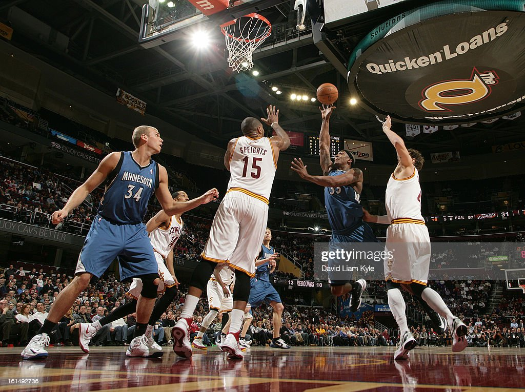 Dante Cunningham #33 of the Minnesota Timberwolves shoots against Marreese Speights #15 and Luke Walton #4 of the Cleveland Cavaliers at The Quicken Loans Arena on February 11, 2013 in Cleveland, Ohio.