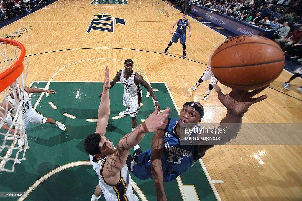 <a gi-track='captionPersonalityLinkClicked' href=/galleries/search?phrase=Dante+Cunningham&family=editorial&specificpeople=683729 ng-click='$event.stopPropagation()'>Dante Cunningham</a> #33 of the Minnesota Timberwolves shoots against Enes Kanter #0 of the Utah Jazz at EnergySolutions Arena on February 22, 2014 in Salt Lake City, Utah.