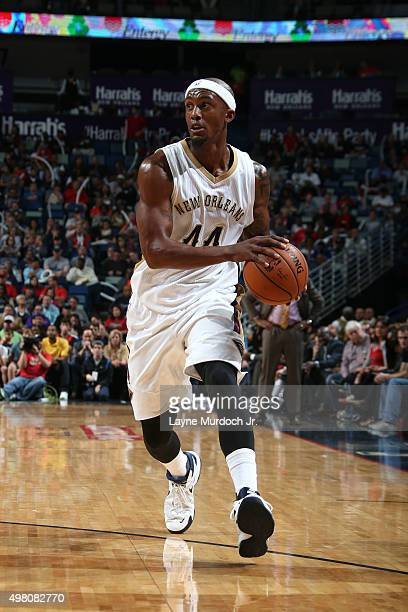 Dante Cunningham of the New Orleans Pelicans drives to the basket against the San Antonio Spurs on November 20 2015 at the Smoothie King Center in...