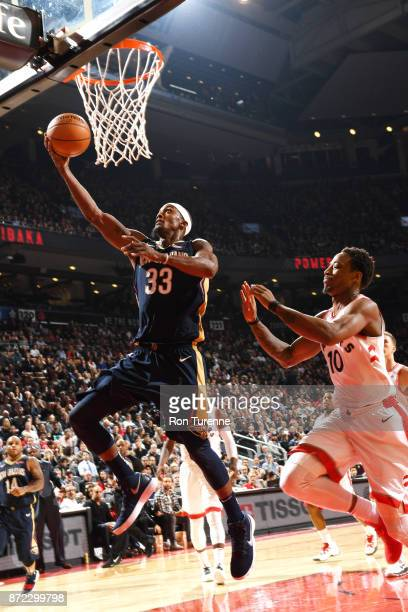 Dante Cunningham of the New Orleans Pelicans goes to the basket against DeMar DeRozan of the Toronto Raptors on November 9 2017 at the Air Canada...