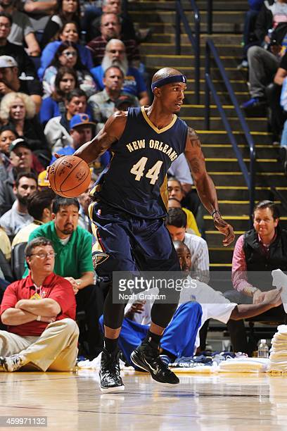 Dante Cunningham of the New Orleans Pelicans handles the ball against the Golden State Warriors on December 4 2014 at Oracle Arena in Oakland...